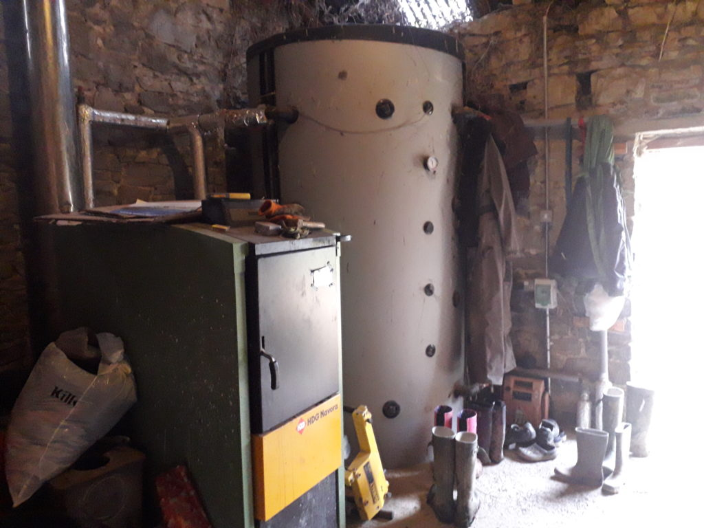 log boiler for home heating image also showing accumulator tank